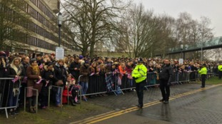 Crowds waiting for the Queen to arrive in Norwich.