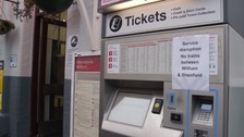 A ticket machine warns commuters about the first of today's problems.