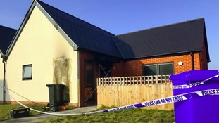 Woman dies in fire that 'engulfed' bungalow.