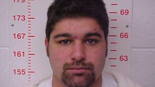 Handout of Lammers, 20, is shown in this booking photo in Bolivar, Missouri
