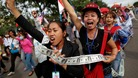 Hundreds of protesters calling for human rights gather in front of Cambodia's National Assembly building