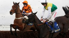 It was an extraordinarily close race between Many Clouds (nearside) and Thistlecrack.