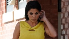 Jill Kelley walks out of her home toward her car in Tampa
