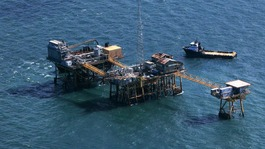 Rescue crew surrounds an oil platform which exploded early this morning in the Gulf of Mexico