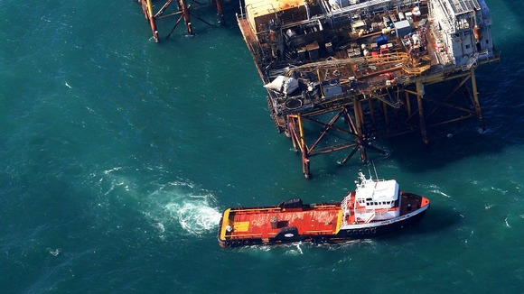 Rescue crew surrounds an oil platform