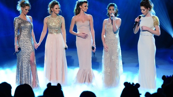 Nicola Roberts, Nadine Coyle, Kimberley Walsh, Cheryl Cole and Sarah Harding of girlband Girls Aloud live on stage.