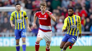 Middlesbrough's Patrick Bamford (centre) and Accrington Stanley's Janoi Donacien (right) battle for the ball during the Emirates FA Cup