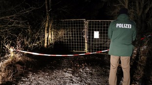 Police officer at closed off entrance to a private ground near Arnstein, Germany