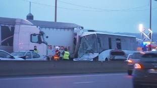 A truck and two buses crashed into each other