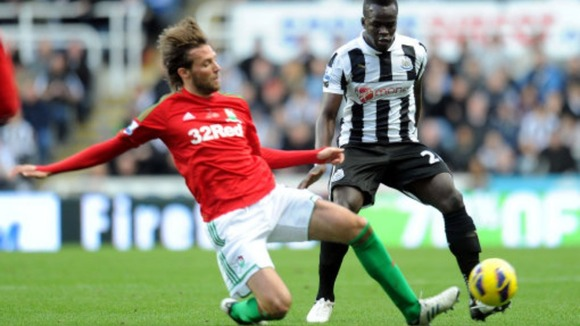 Michu and Cheik Tiote