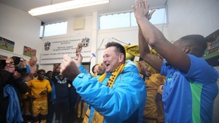 Sutton United manager Paul Doswell celebrates with his players