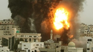 An explosion and smoke are seen after Israeli strikes in Gaza City November 17, 2012.