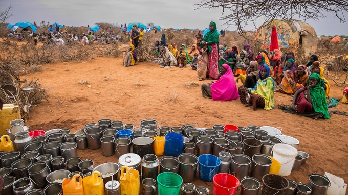 People wait for food and water as a drought hits the region