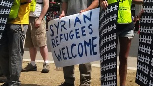 Protests for Britain to admit more refugees fleeing the Syrian conflict were held in Parliament Square.