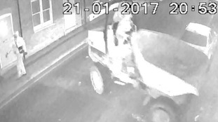 Three men drove a dumper truck into a motorcycle shop in Dunstable.
