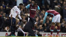 West Ham United's Cheikhou Kouyate is treated for an injury during the Premier League match at White Hart Lane.
