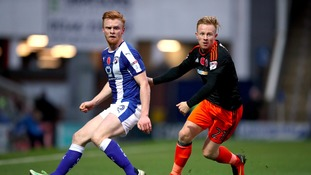 Liam O'Neil (left) is back at Cambridge United.