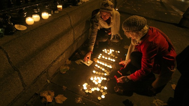 Candles are left in tribute in Dublin, after thousands marched demanding legislation on abortion after the death of Savita Halappanavar. 