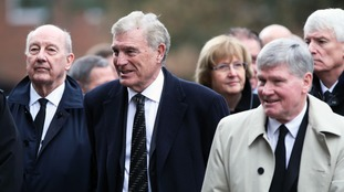 Sir Trevor Brooking and Pat Rice arrived alongside around 450 others at St Mary's Church.