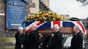 The former England manager's coffin was draped in the Union flag.