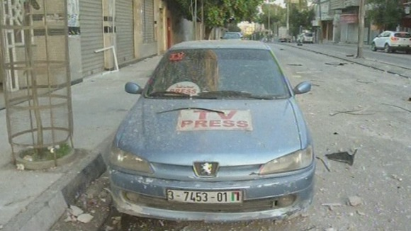 A vehicle shown outside a building housing journalists after the air strike
