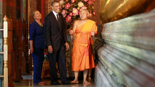 President Obama and Hillary Clinton stand with a monk at the base of the Reclining Buddha