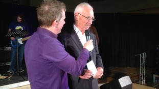 Pastor David Hinds welcoming Mike Howitt back from his hitchhike to South Africa