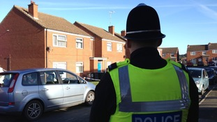 Police officer stands guard in Denaby