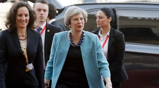 Theresa May arrives in Valetta.