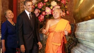 President Obama and Hillary Clinton shared a joke with a monk at the base of the Reclining Buddha