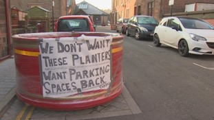 Residents taped signs to the planters.