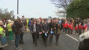 Local pupils are the first to cross the bridge