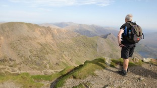 A walker at the summit of Snowdon