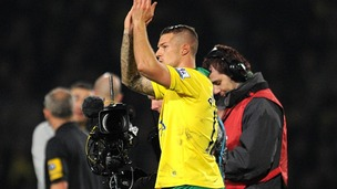 Norwich City's Anthony Pilkington celebrates victory after the final whistle during the Barclays Premier League match at Carrow Road