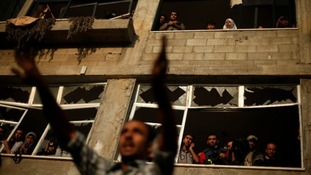 A Palestinian man reacts at the scene of an Israeli air strike on a house in Gaza City