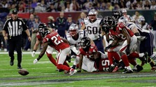 Atlanta Falcons' Robert Alford recovers a fumble during the first half