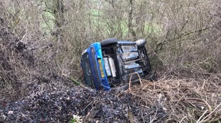Woman escapes injury after car overturns
