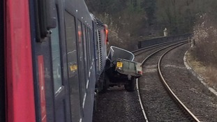 Man dies after his vehicle is hit by train at level crossing