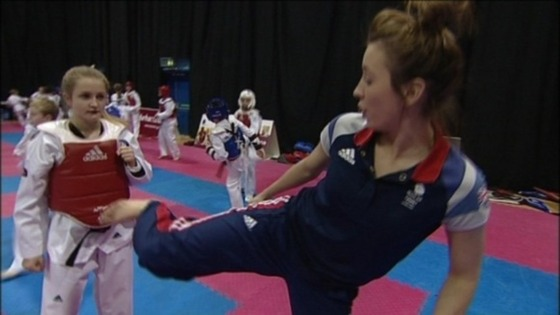 Jade Jones shows a Spennymoor Taekwondo student some of her moves
