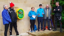 At the official unveiling of the Stewart Park defibrillator: (L-R) Parkrun North East Ambassador Pete Richardson, MFC Head of UK recruitment Gary Gill, Swift-tees founder Rosanne Lightfoot, Swift-tees Chair Michael McCann, Friends of Stewart Park Chairman Tom Mawston and Middlesbrough South and East Cleveland MP Tom Blenkinsop.