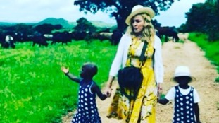 Madonna shares first snap of newly adopted twin daughters