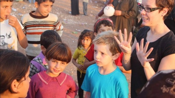 Joseph Purcell meeting children in Syria.