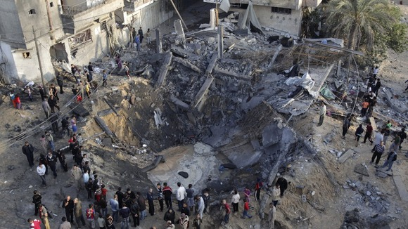 An Israeli air strike destroyed a house and created a crater in the earth.