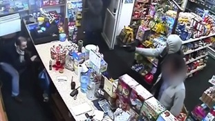 Brave shopkeeper fights off armed robber with pet repellent spray