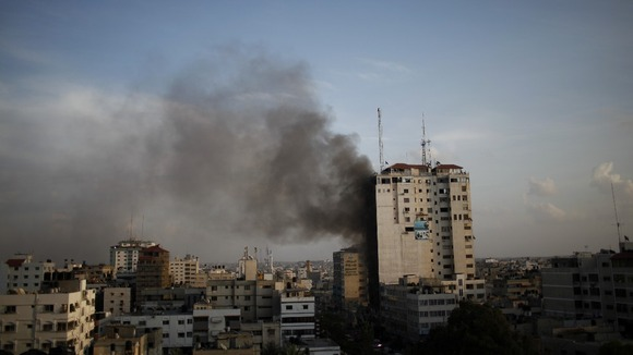 Smoke rises after an Israeli airstrike on an office that houses international media in Gaza City