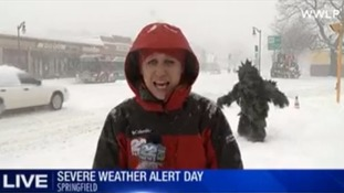 The reporter's serious report on severe weather ended in comical fashion.