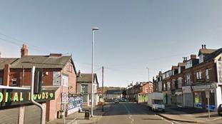 The Harehills Lane area in Leeds has been cordoned off.