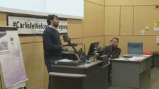 Yashar Kassar speaking at the event at the University of Cumbria.