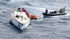 Crew from the Type 45 destroyer rescue the crew of the stricken 60ft Clyde Challenger racing yacht.