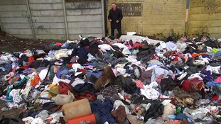 ITV News' Chris Choi pictured at a fly-tipping site in Manchester.